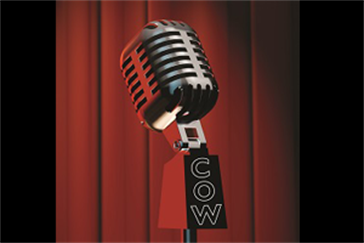 Comedy microphone with COW running dowd the side