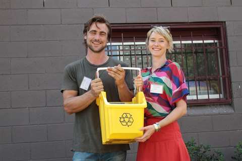 Couple with recycling bucket.jpg